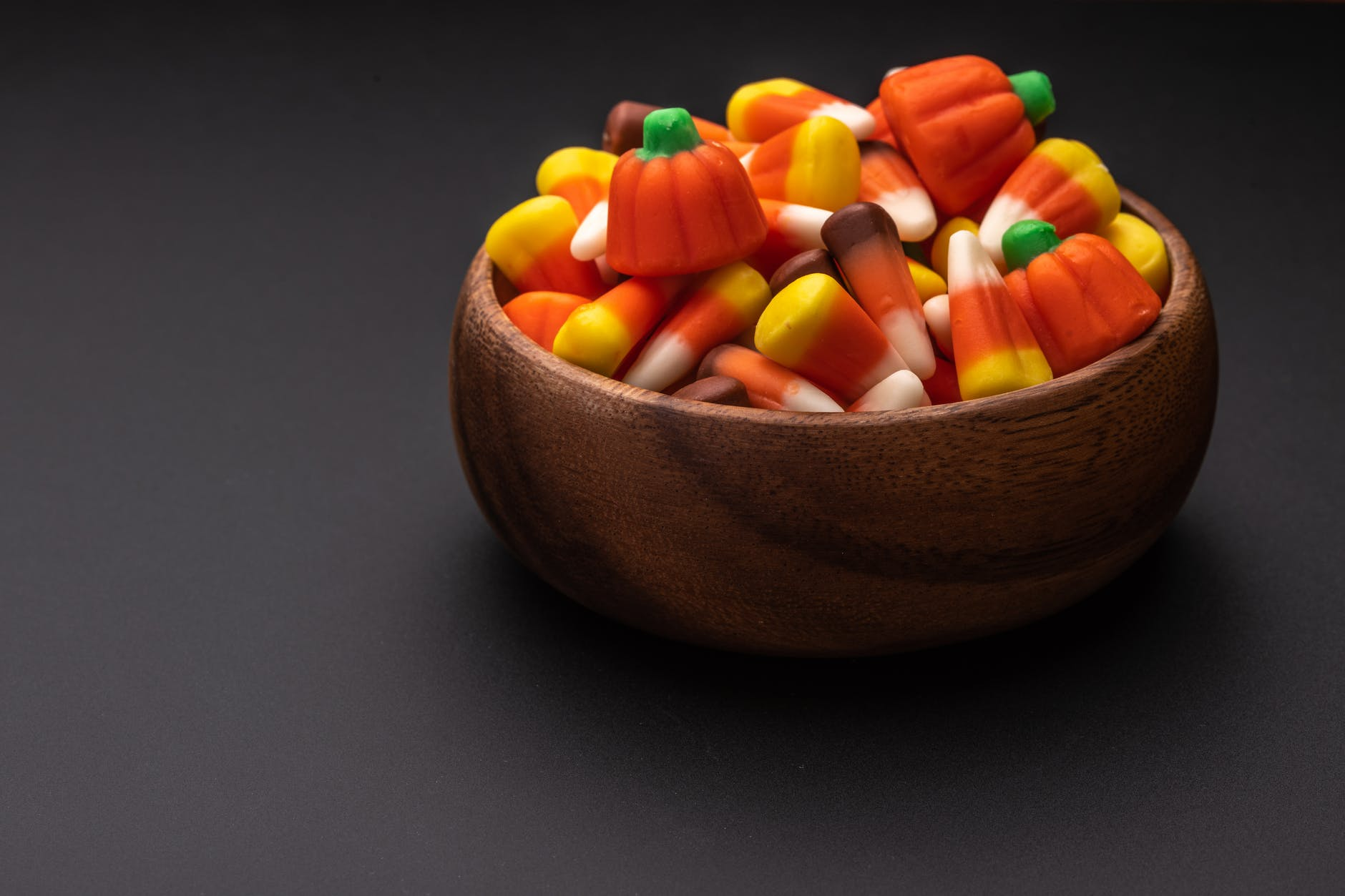 bowl with yummy colorful gummies on table